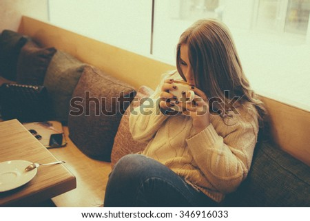 portrait of beautiful girl drinking  coffee - stock photo