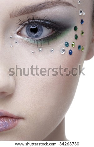 portrait of beautiful girl' half-face with mermaid bodyart - stock photo
