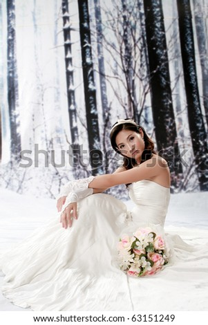 Portrait of beautiful girl in bride dress - stock photo