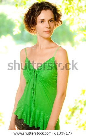 Portrait of beautiful girl in green vest. - stock photo