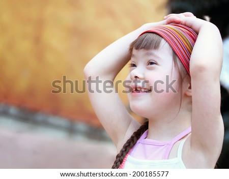 Portrait of beautiful girl in the city - stock photo