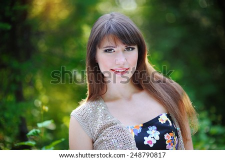 portrait of beautiful girl in the park. - stock photo