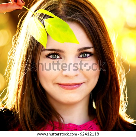 portrait of beautiful girl on nature background - stock photo