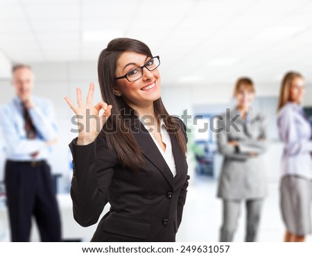 Portrait of beautiful girl showing ok sign and smiling - stock photo