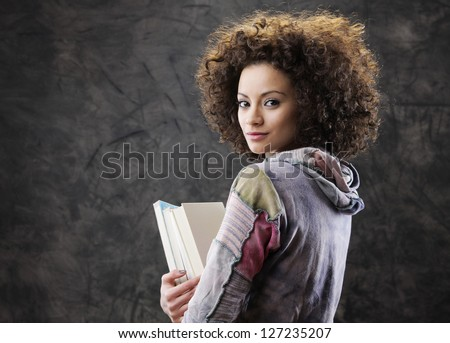 Portrait of beautiful girl student with books - stock photo