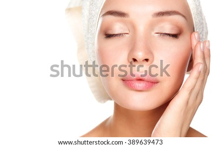 Portrait of beautiful girl touching her face with a towel on  head - stock photo
