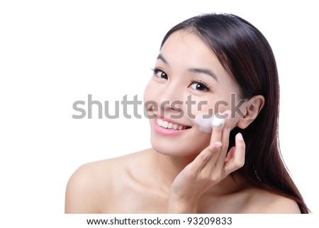 Portrait of beautiful girl touching her pretty face with cleansing foam - white background, model is a asian beauty - stock photo