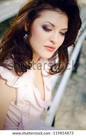 Portrait of beautiful girl walking through the park - stock photo