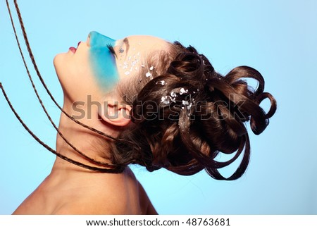 portrait of beautiful girl with blue stripe facial bodyart and fantasy hair-do with several thin braids - stock photo