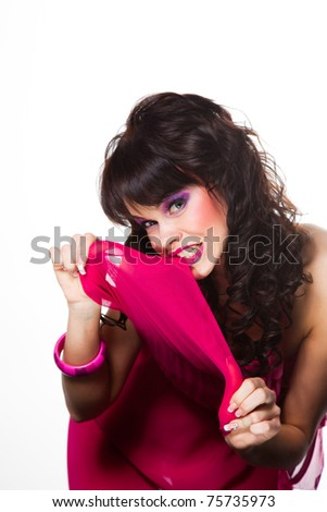 Portrait of beautiful girl with dark long curly hair and vibrant make-up wearing pink on white background - stock photo