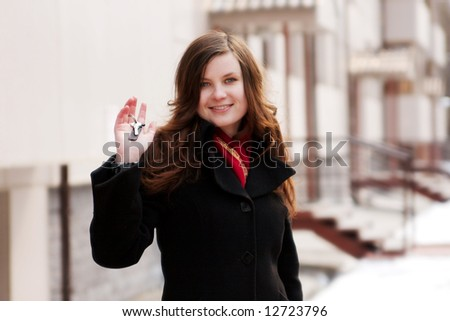 portrait of beautiful girl with key in hand - stock photo