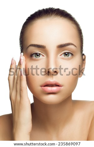 Portrait of beautiful girl with perfect clean skin. Touching your face with your fingers with long nails on a white background - stock photo