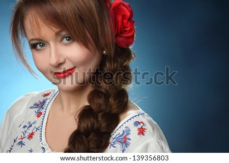portrait of beautiful girl with scythe - stock photo