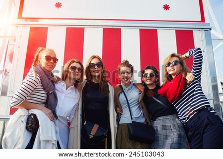 Portrait of beautiful group of women having fun at sunny day during their holidays vacation - stock photo