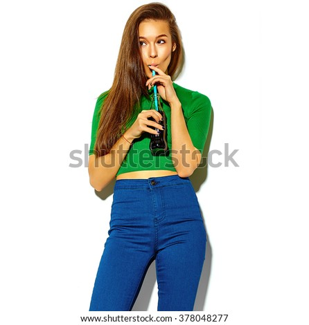 portrait of beautiful happy cute brunette woman girl in casual green hipster summer clothes with no makeup isolated on white drinking cola from bottle with straw - stock photo