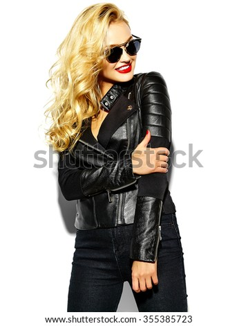 portrait of beautiful happy cute smiling blonde woman bad girl in casual black hipster clothes with red lips in sunglasses - stock photo