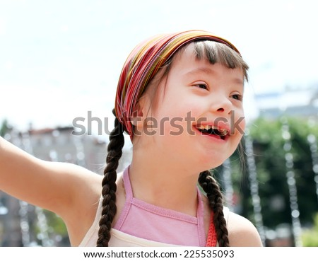 Portrait of beautiful happy girl in the city - stock photo