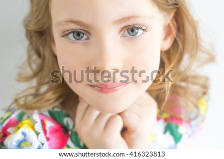 Portrait of beautiful happy little girl with hands - stock photo