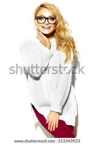 portrait of beautiful happy sweet cute smiling blonde woman girl in casual hipster warm white sweater clothes, in glasses - stock photo