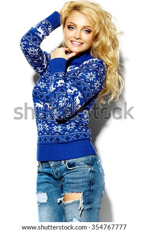 portrait of beautiful happy sweet smiling blonde woman girl in casual hipster warm winter clothes, in blue sweater with deers - stock photo