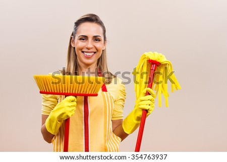 Portrait of beautiful housewife ready for cleaning.Ready for cleaning - stock photo