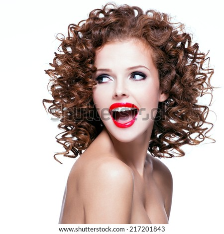 Portrait of beautiful laughing woman with brunette curly hair and bright make up looking at camera - isolated on white.   - stock photo