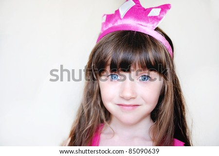 Portrait of beautiful little girl in pink tiara, isolated - stock photo