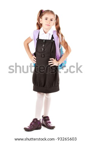 Portrait of beautiful little girl in school uniform with backpack. Isolated on white - stock photo