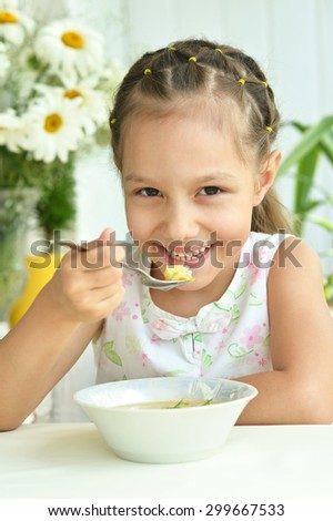 Portrait of  Beautiful little girl with soup - stock photo