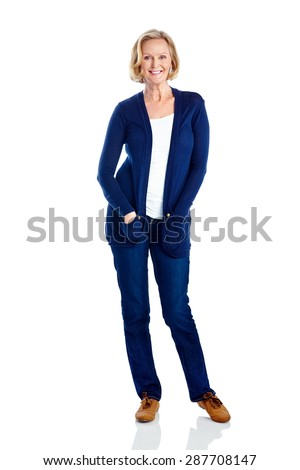 Portrait of beautiful mature businesswoman standing on white background - stock photo