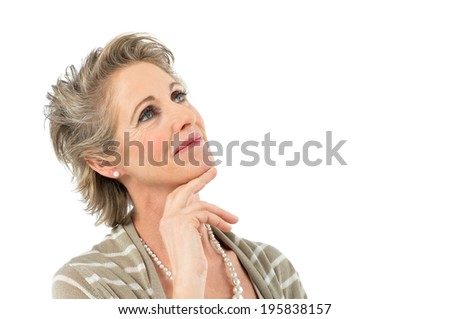 Portrait Of Beautiful Mature Woman Daydreaming Isolated On White Background - stock photo