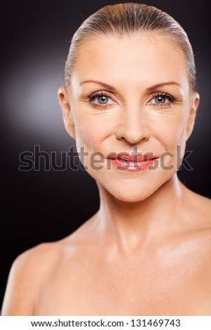 portrait of beautiful mature woman with lovely skin close up - stock photo