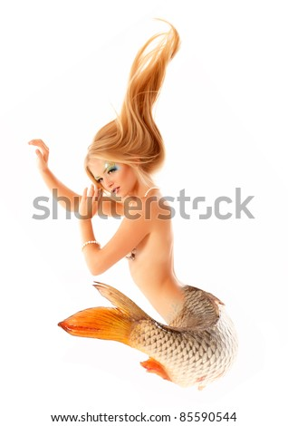 portrait of beautiful mermaid girl with fish tail and long blond hair magic mythology being original photo compilation isolated on white background - stock photo