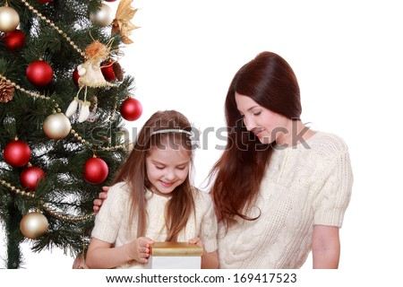 Portrait of beautiful mother and little girl having fun time on Christmas  - stock photo