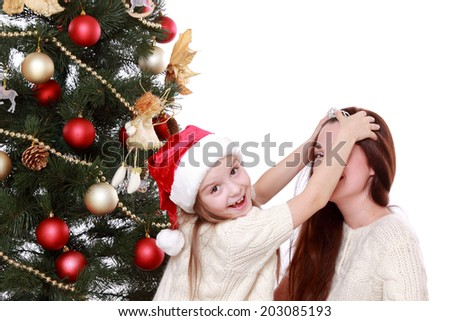 Portrait of beautiful mother and little girl having fun time on Christmas on Holiday theme - stock photo