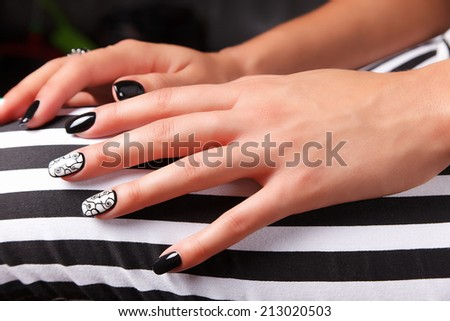 Portrait of beautiful nail art of manicured and painted fashion  - stock photo