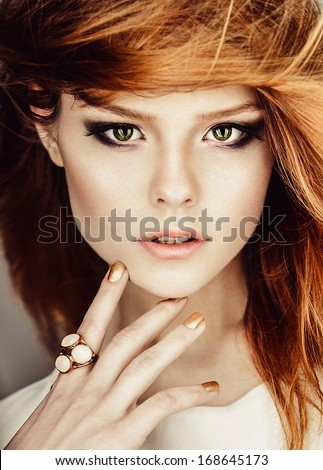 Portrait of beautiful red-haired girl face closeup - stock photo
