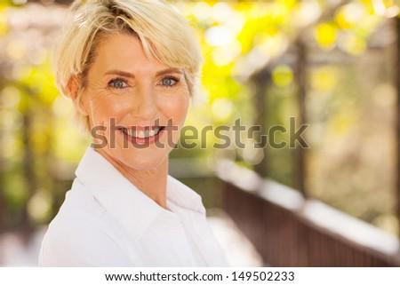 portrait of beautiful senior woman outdoors - stock photo