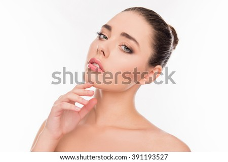 Portrait of beautiful sensual girl touching her chin - stock photo