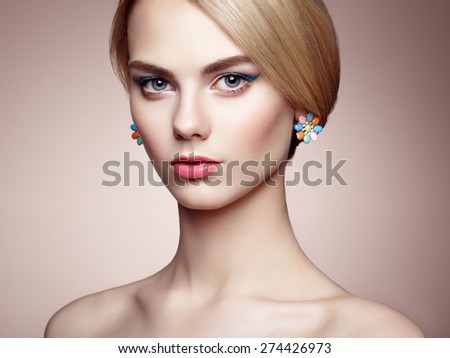 Portrait of beautiful sensual woman with elegant hairstyle.  Perfect makeup. Blonde girl. Fashion photo. Jewelry - stock photo