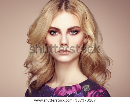 Portrait of beautiful sensual woman with elegant hairstyle.  Perfect makeup. Blonde girl. Fashion photo. Jewelry and dress - stock photo