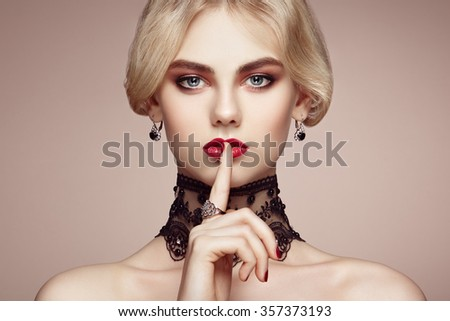 Portrait of beautiful sensual woman with elegant hairstyle.  Perfect makeup. Blonde girl. Fashion photo. Jewelry and lace - stock photo