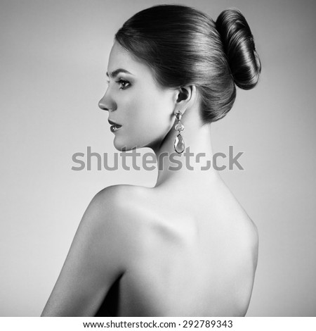 Portrait of beautiful sensual woman with elegant hairstyle.  Perfect makeup. Brunette girl. Fashion photo - stock photo