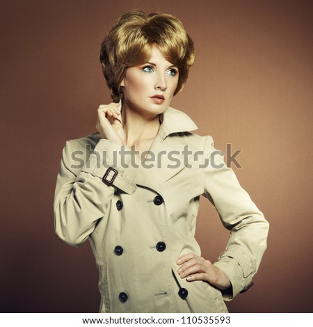 Portrait of beautiful sensual woman with elegant hairstyle. Retro hairdo - stock photo