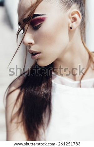 Portrait of beautiful sensual young girl close-up, outdoors, the concept of health and beauty - stock photo