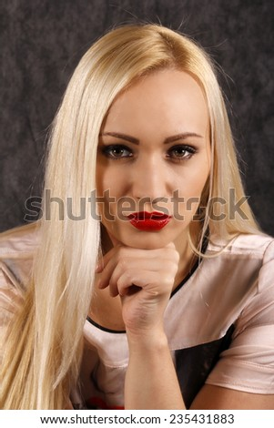 Portrait of beautiful sexy blond with hot red lips. - stock photo