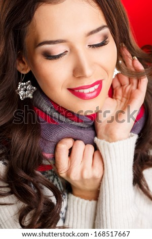 portrait of beautiful sexy brunette girl female model with bright makeup and red lips and her reflection in mirror table on dark with perfect skin - stock photo