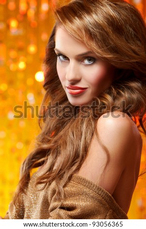 Portrait of beautiful sexy woman on yellow background - stock photo