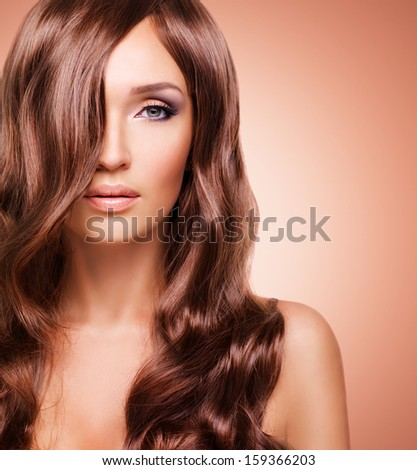 Portrait  of beautiful sexy woman with long red hairs. Closeup face  with curly hairstyle - studio - stock photo