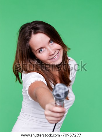 portrait of beautiful singer girl with microphone in hand - stock photo